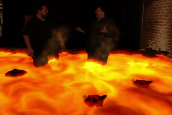 Ryan Davis and Minime Tim Schafer Stand In Lava