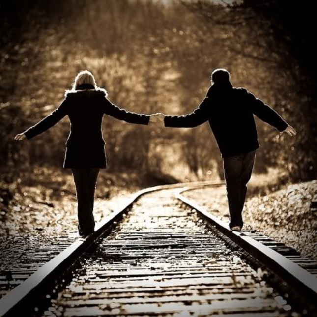 Walking Train Tracks Couple Holding Hands in Love