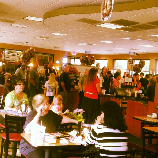 People eating at ChickfilA Appreciation Day!