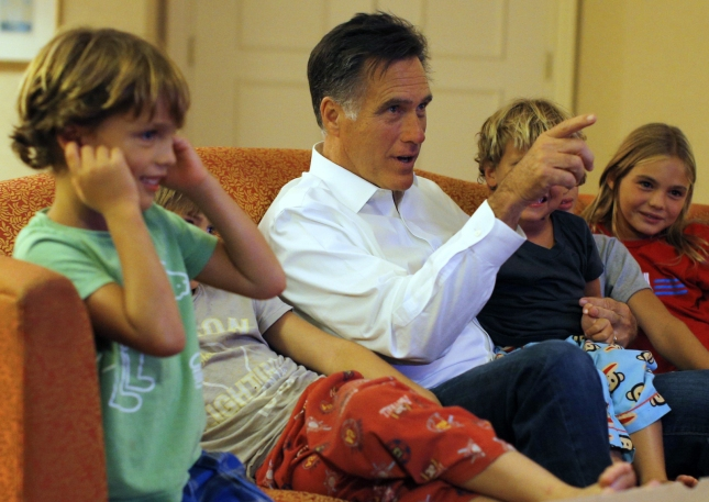 Mitt Romney and Smiling Grandchildren on Couch