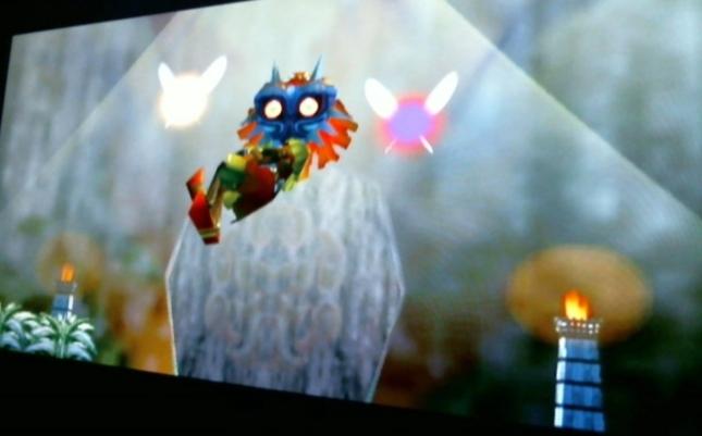 Zelda Majoras Mask Evil Skullkid Wearing Mask Bathed In Light From Beginning of Game Screenshot